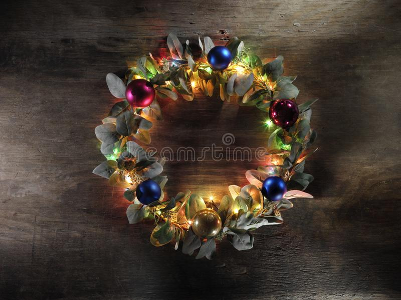 Christmas decoration on vintage wood background. High-definition stillife photograpy dramatic light. shiny lightly object royalty free stock image