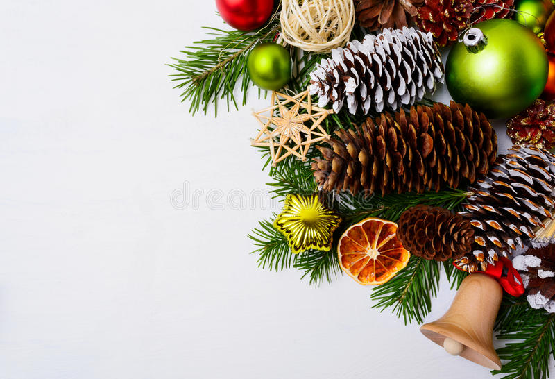 Christmas decoration with wooden jingle bell and straw ornaments royalty free stock photos
