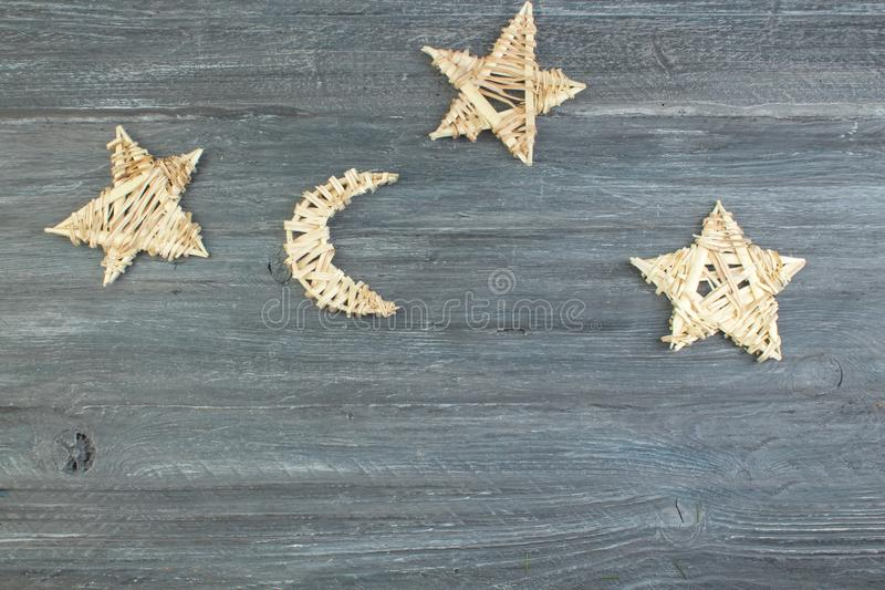 Christmas decoration wooden star with Merry Christmas sign isolated on wooden background. Top view with copy space. stock photography