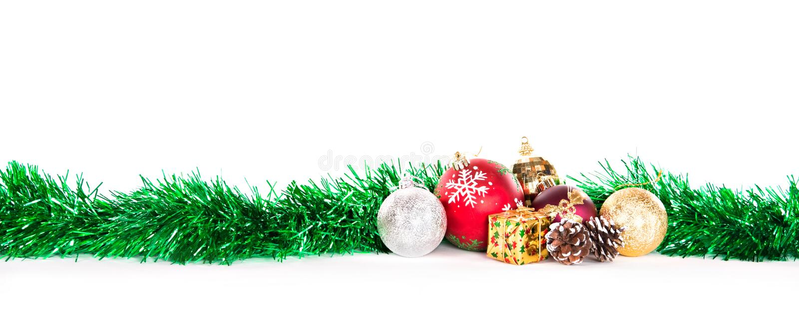 Christmas decorations. Tinsel and globes, decorations for Christmas, isolated on white background stock images