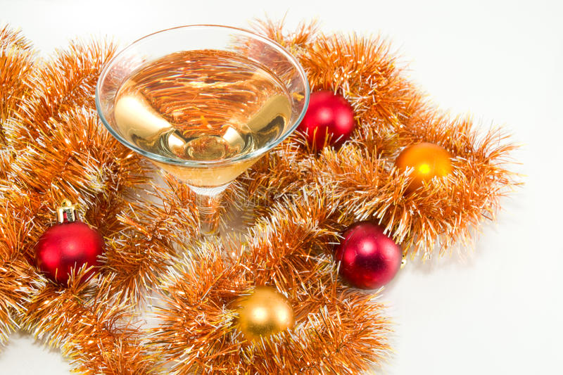 Christmas Decorations. Wine glass with champagne among the Christmas decorations royalty free stock photo