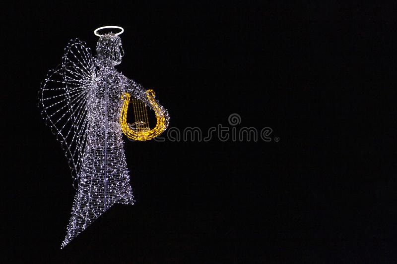 Christmas decorations, angel figure from various lights stock photography