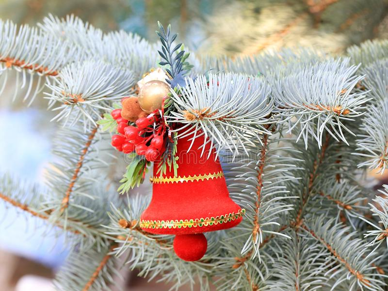 Christmas decorations in anticipation of the event. Christmas decorations on the branches of a beautiful live spruce in anticipation of the event royalty free stock images