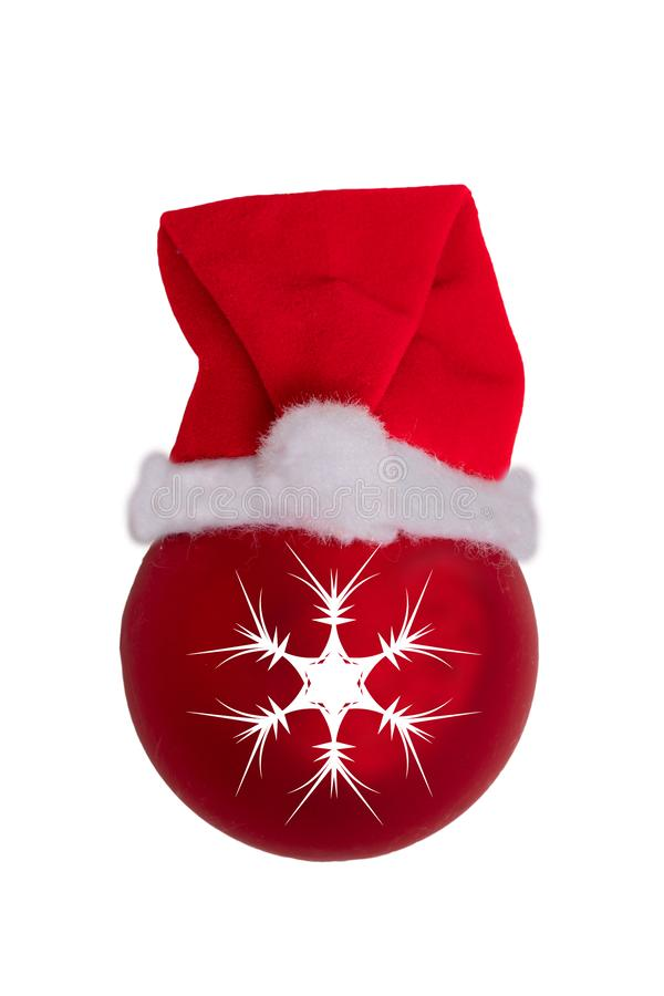 Christmas decorations background. Closeup of a red christmas ball with Santa Claus hat isolated on a white background royalty free stock image