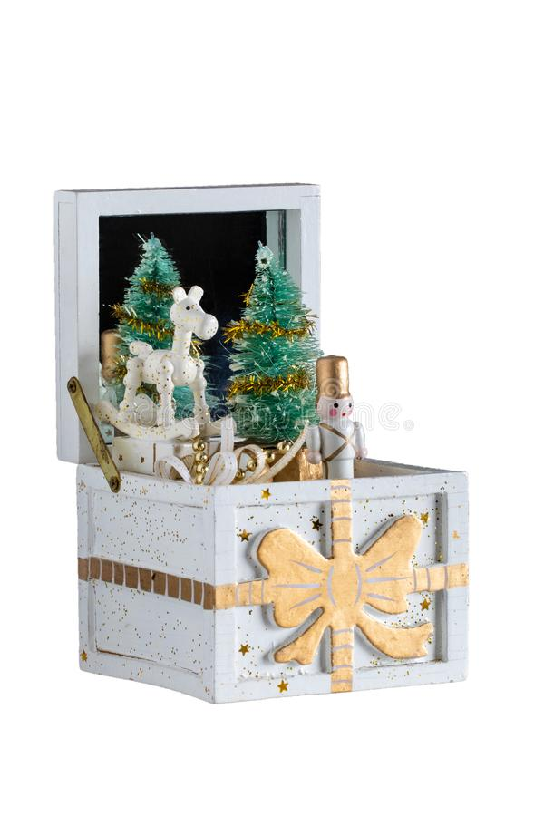 Christmas decorations background. Old wooden music box with a christmas song. The Christmas tree and the figures are moving. royalty free stock image