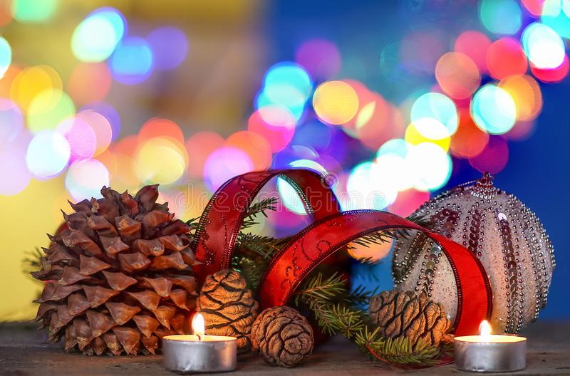 Christmas decorations with ball, red ribbon, under defocused background. stock images