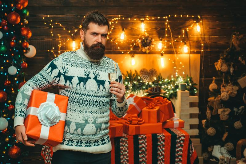 Christmas decorations. Bearded modern santa claus in knitted sweater. Christmas man in santa hat. Santa in home. stock image