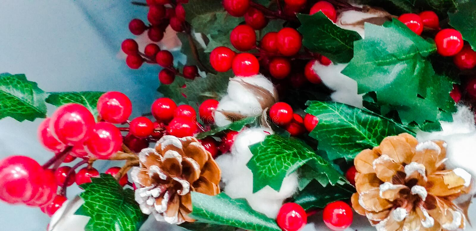 Christmas decorations with beautiful classic Christmas red with pine cones and baxxhe as tradition dictates royalty free stock images