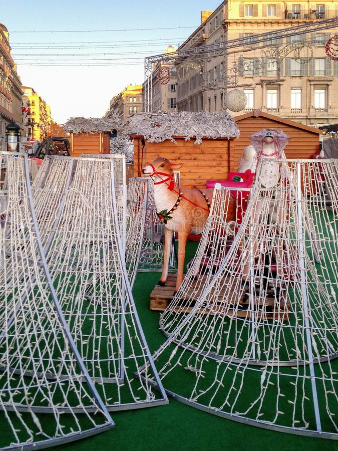 Christmas decorations being installed for the Christmas Market in Marseille, old port square royalty free stock photo