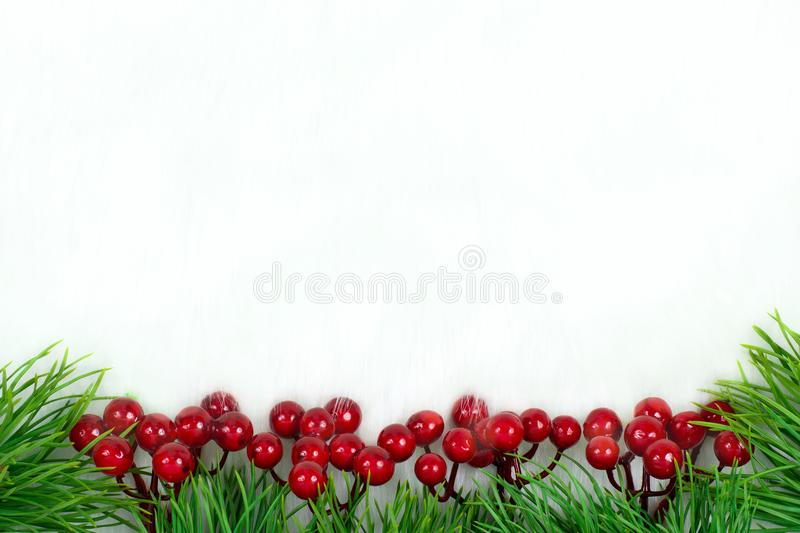 Christmas decorations berries and Christmas trees. royalty free stock photos