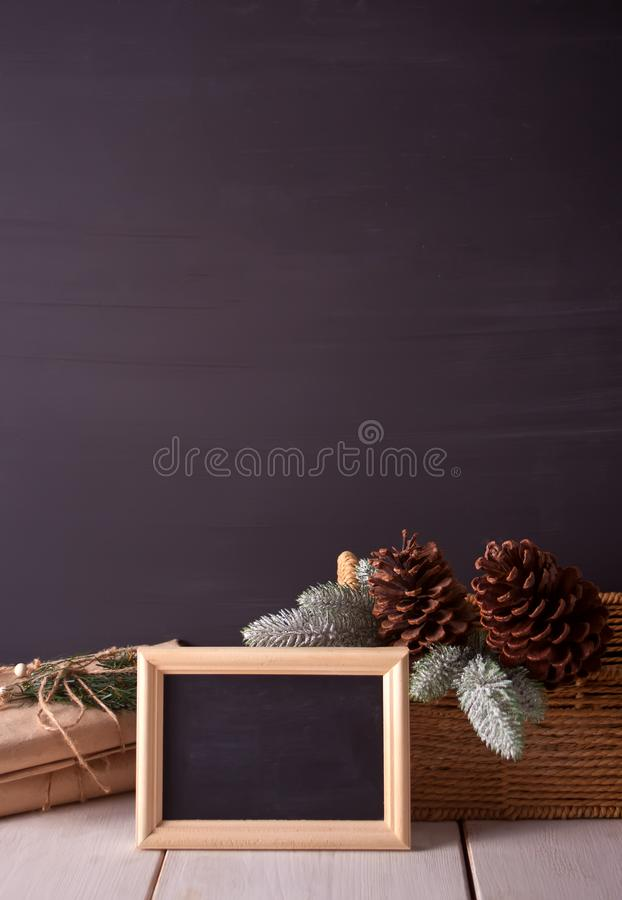 Christmas decorations with blackboard on the black background with copy space stock images