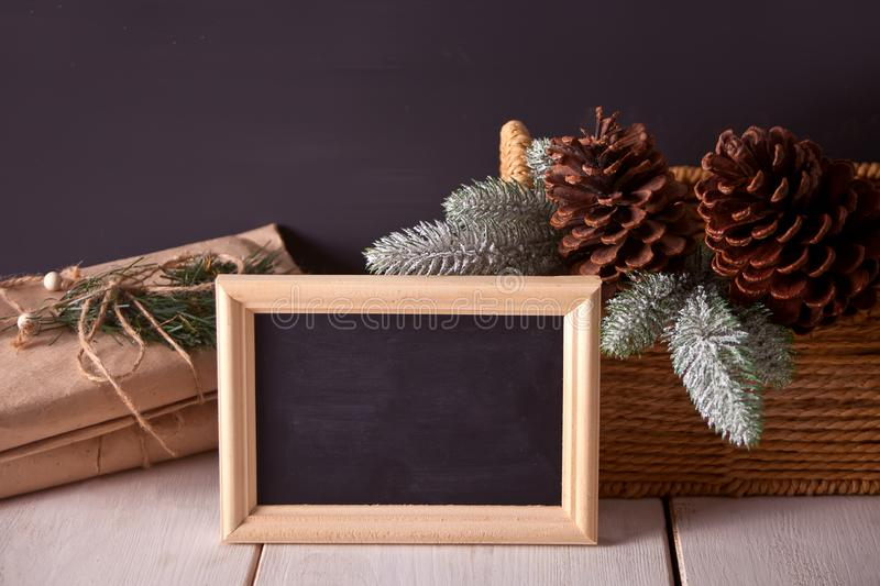 Christmas decorations with blackboard on the black background stock image
