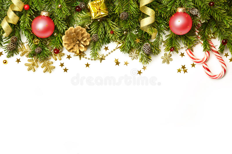 Christmas Decorations border isolated on white background. Christmas tree branches with red baubles, golden stars, snowflakes isolated on white - horizontal stock photography