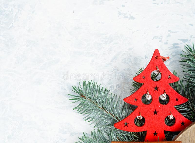 Christmas decorations and branches of a New Year tree on abstract background stock photos