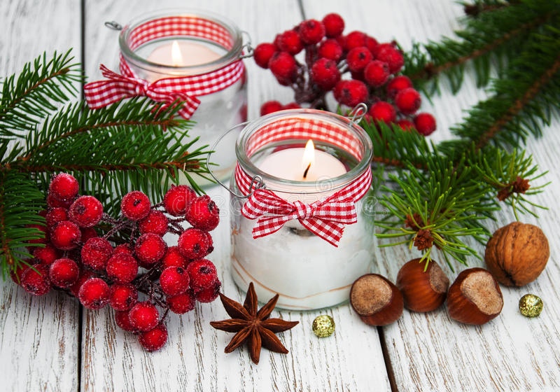 Christmas decorations candles in glass jars with fir royalty free stock images