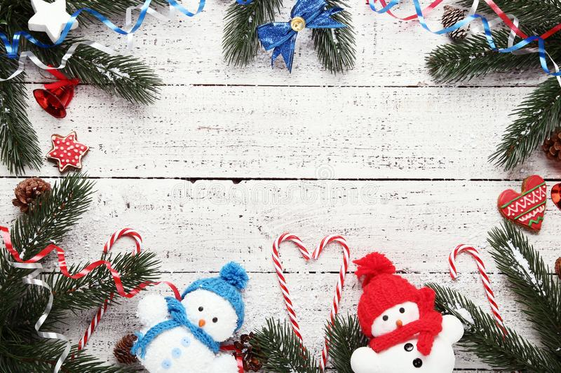 Christmas decorations with candy canes. And small snowmans on white wooden table royalty free stock images
