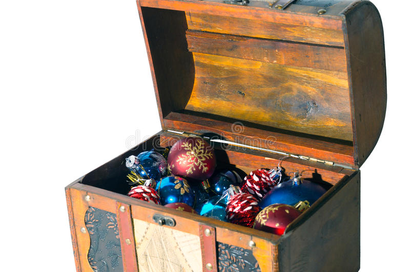 Christmas decorations in a chest isolated on white royalty free stock images