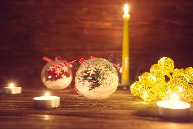 christmas decorations with christmas lights on wooden table