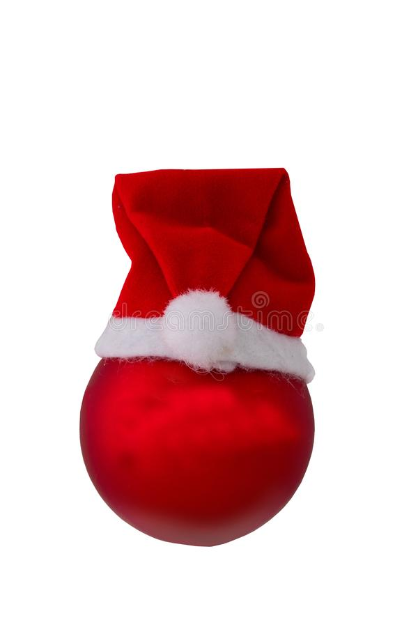 Christmas decorations. Closeup of a red christmas ball with Santa Claus hat isolated on a white background. royalty free stock image