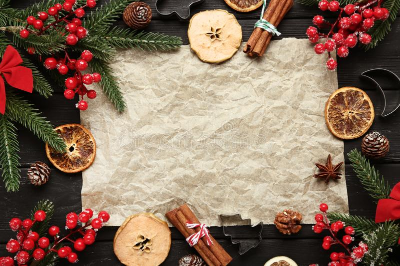 Decorations with dry fruits. Christmas decorations with dry fruits and blank sheet of paper stock images