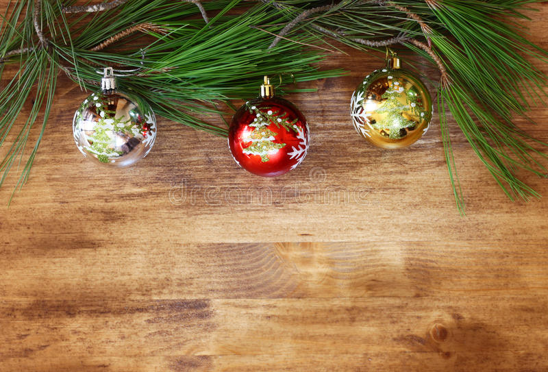 Christmas decorations and fir on a wooden board. top view. filtered image instagram style. stock image