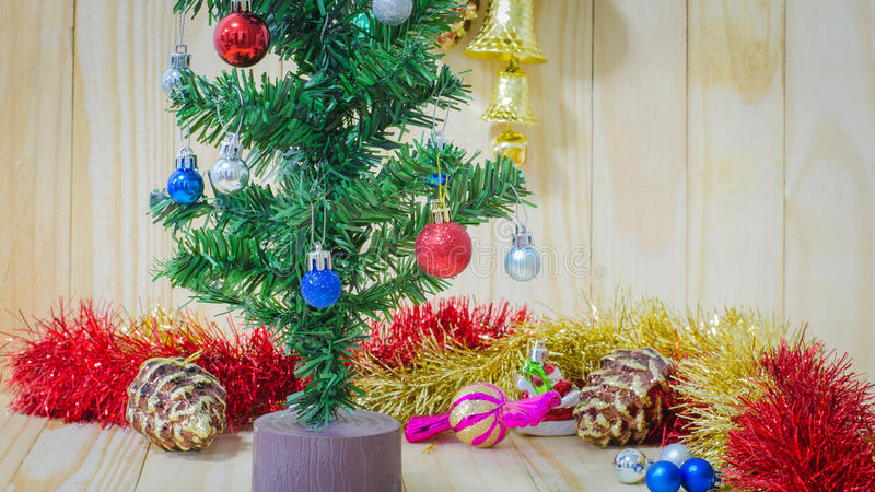 Christmas decorations focusing on red ball on pine tree stock image