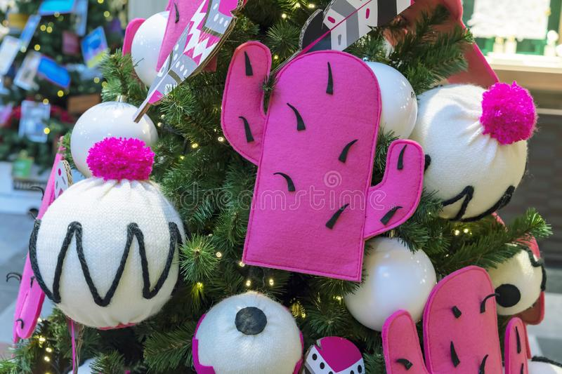 Christmas decorations in the form of white knitted hats and pink cacti royalty free stock photography
