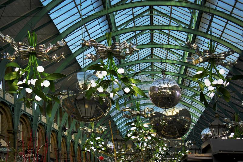 Christmas decorations and giant baubles in Covent Garden Market, one of the most popular tourist sites in London, UK stock images