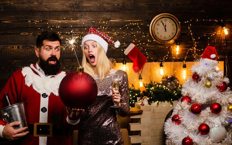 Christmas decorations and gift box on wooden background. Portrait of surprised and funny couple. Comic couple: crazy royalty free stock image
