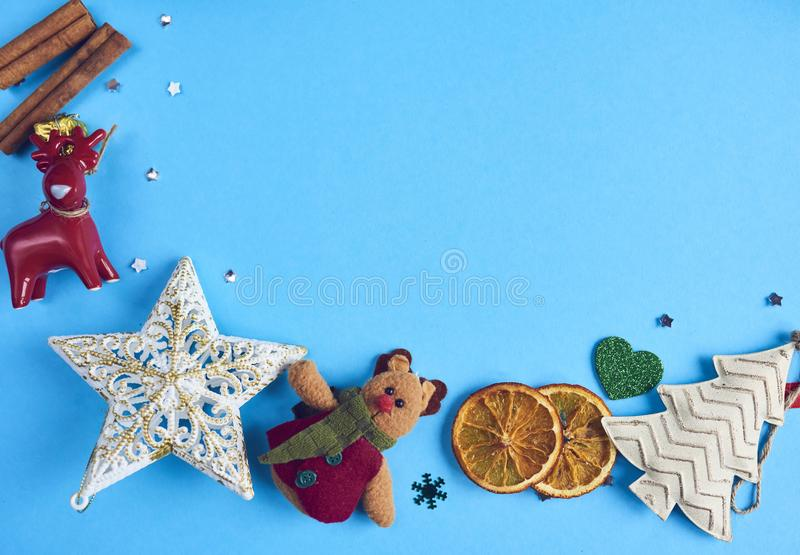 Christmas decorations and gifts over blue background. Design mockup royalty free stock photos