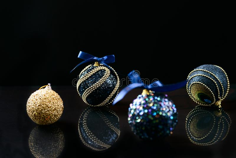 Christmas decorations on glass. Dark blue shining Christmas decorations on glass royalty free stock images
