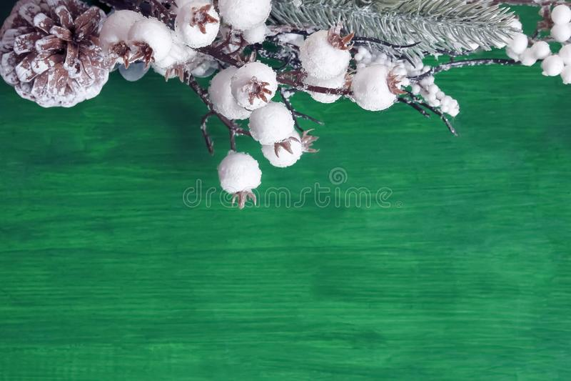Christmas decorations on a green wooden background. White, berries, xmas, tree, red, holiday, copy, space, ornament, branch, new, year, celebration, color stock photos