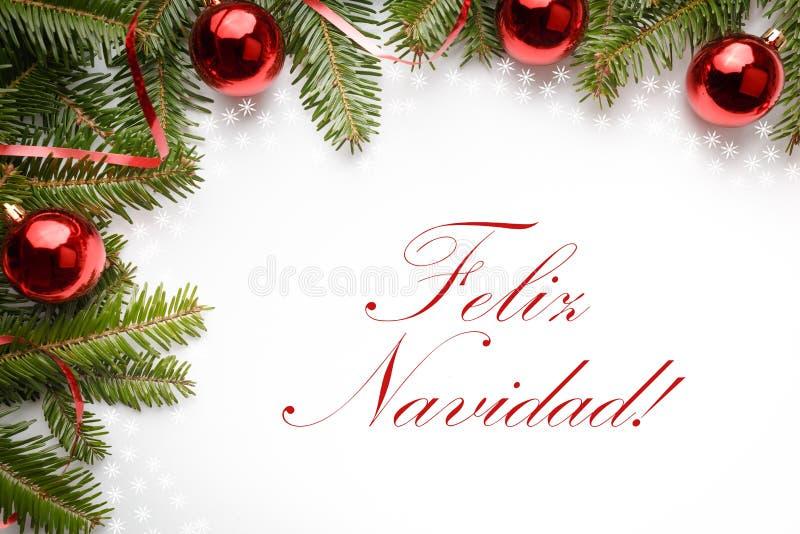 Christmas decorations with the greeting `Feliz Navidad!` in Spanish. Decoration made of fir branches and red Christmas ornaments with the greeting `Feliz Navidad royalty free stock photos