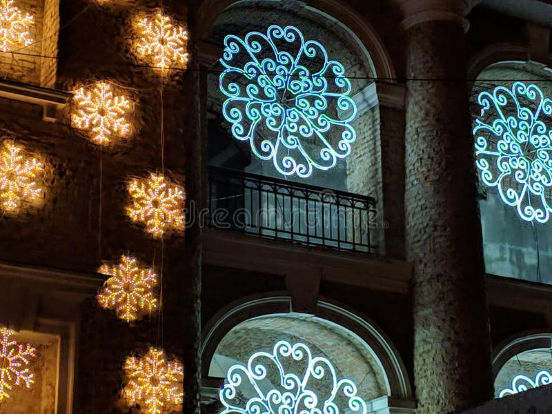 Christmas decorations, illumination on the building, night city stock photo
