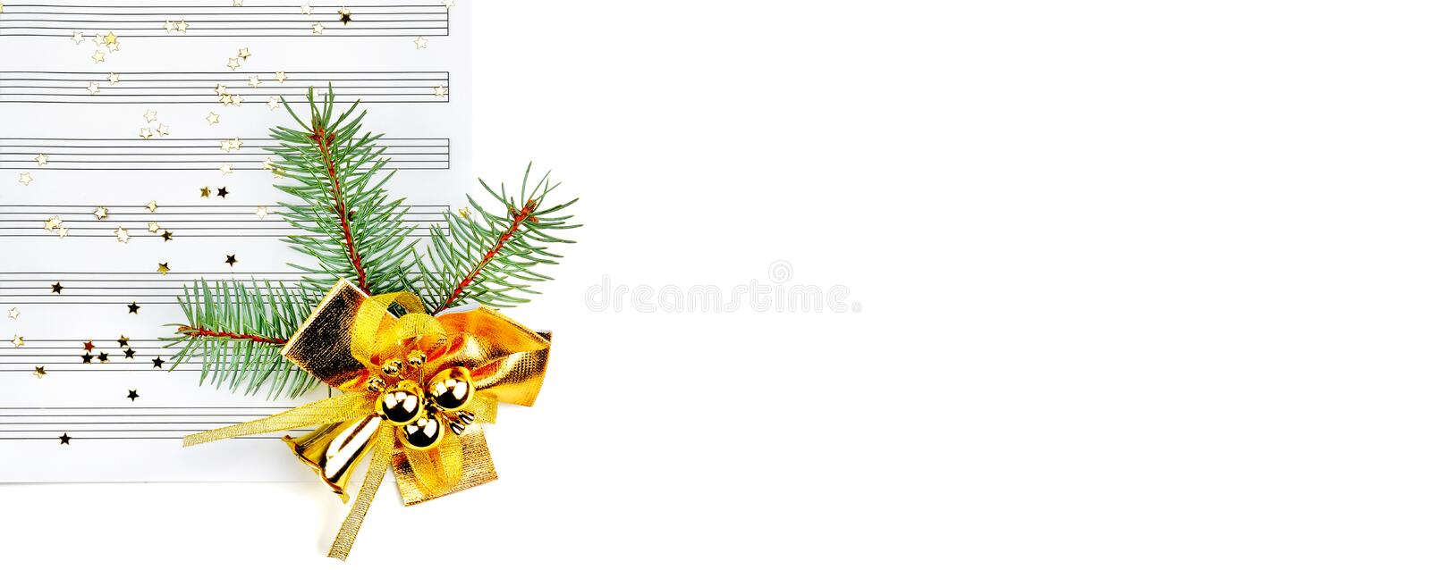 Christmas decorations isolated on white background. Free space for text. Wide photo. Christmas decorations and music sheet isolated on white background. Free royalty free stock image