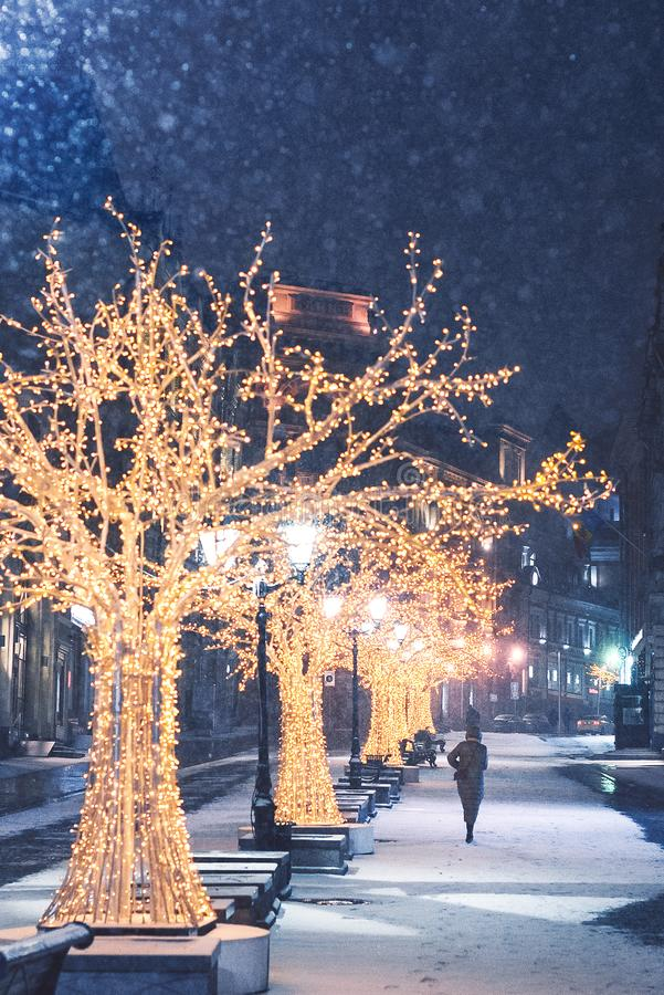 Christmas decorations on Kuznetsky Most. Night illumination. Lanterns wine glasses and golden trees. Snowy night. stock image