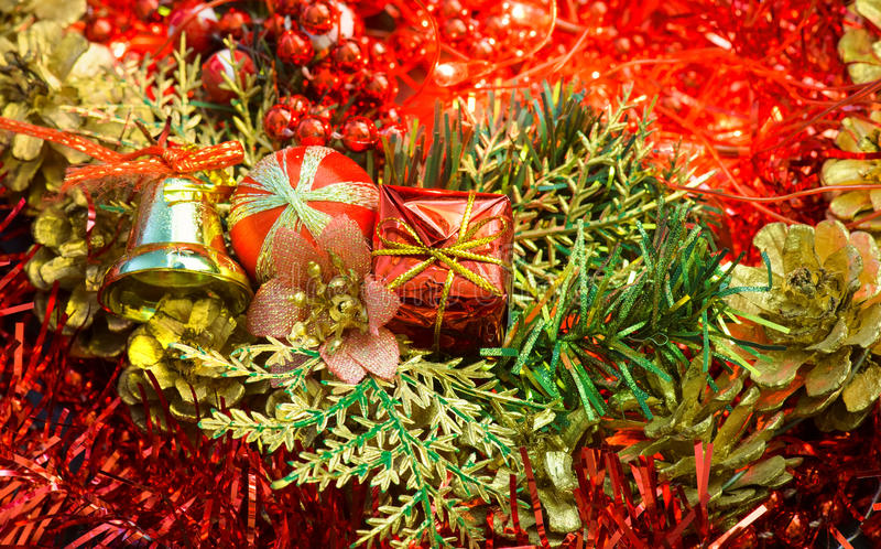 Christmas decorations made of bell and small gift on green royalty free stock image