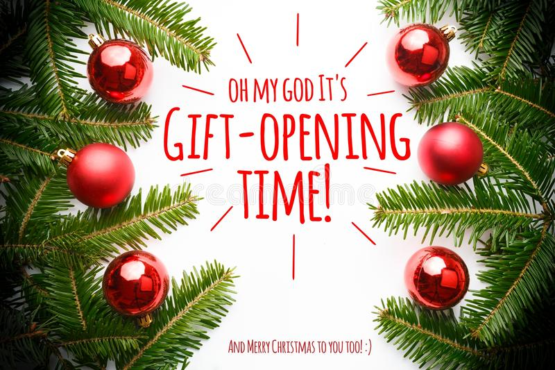 Christmas decorations with the message `Oh my God it`s gift-opening time!` stock photography