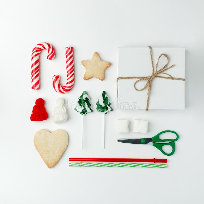 Christmas decorations and objects for mock up template design. Christmas candies, cookies, candy cane, decorative knitted hat stock photos