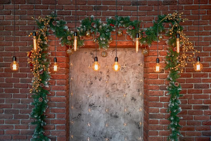 Christmas decorations over the decorative fireplace on the wall stock images