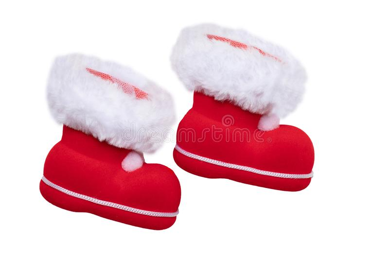 Christmas decorations. A pair of red Christmas boots or Santa Claus boots isolated on a white background royalty free stock photos