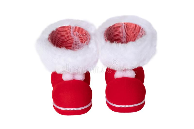 Christmas decorations. A pair of red Christmas boots or Santa Claus boots isolated on a white background stock image
