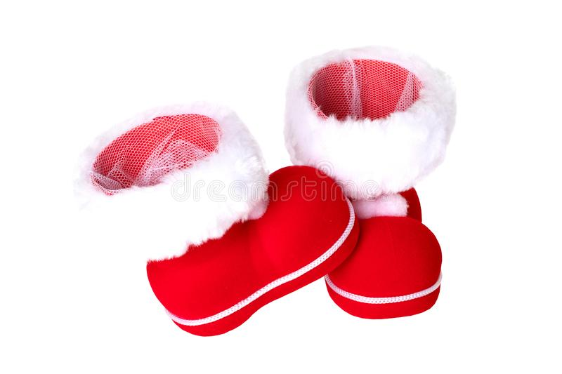 Christmas decorations. A pair of red Christmas boots or Santa Claus boots isolated on a white background royalty free stock images