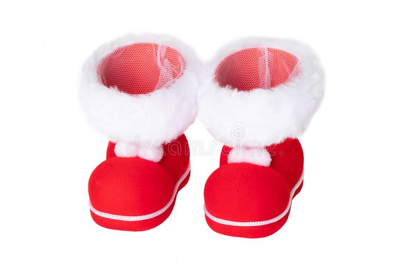 Christmas decorations. A pair of red Christmas boots or Santa Claus boots isolated on a white background stock photo