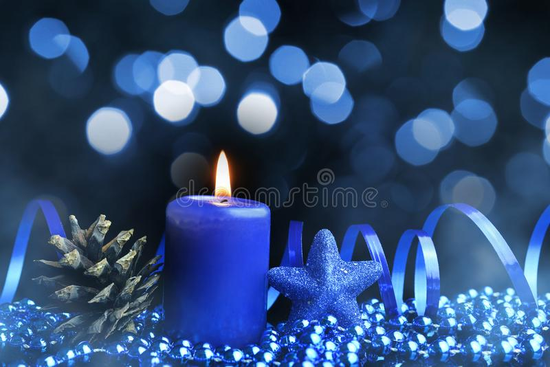 Christmas decorations with pine cone and burning candle. royalty free stock photos