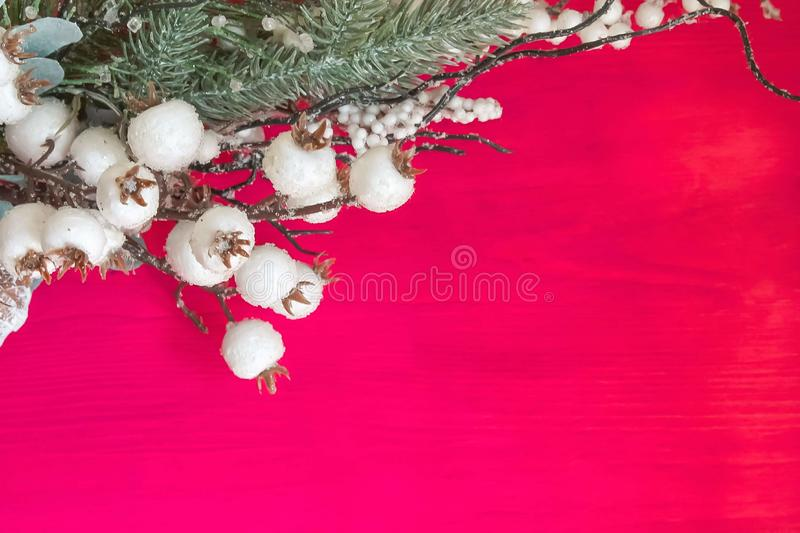 Christmas decorations on a red wooden background. Christmas Decoration Over Wooden Background, white, berries, xmas, tree, red, holiday, copy, space, ornament stock photos