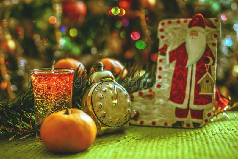 Download Christmas Decorations - Santa Claus, Clock, Tangerines And Garland Stock Photo - Image: 83713720