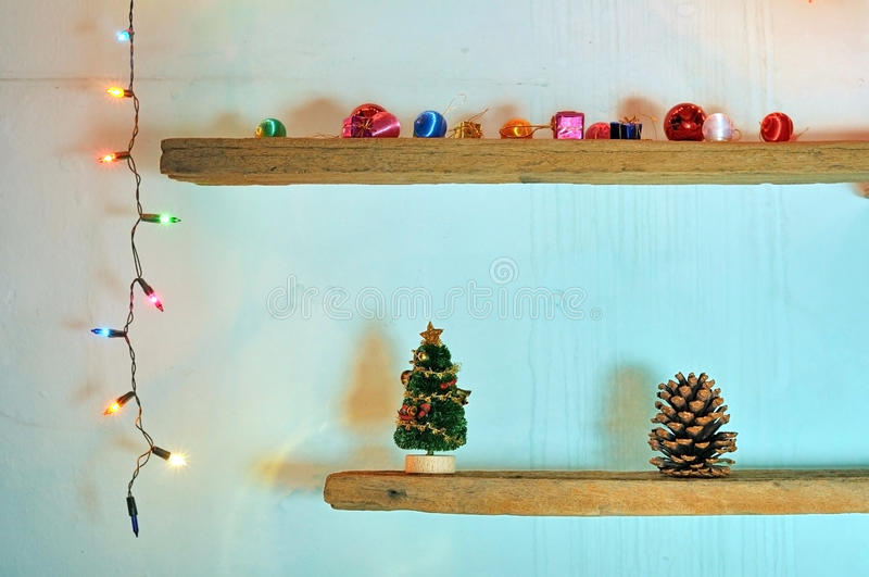 Christmas decorations on shelf with christmas light. Christmas decorations on shelf with colorful christmas light at night stock photo