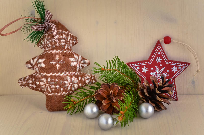 Christmas Decorations on a Shelf. Close up of Christmas Decorations with Fir Cones and Small Silver Baubles on a Wooden Background stock photo