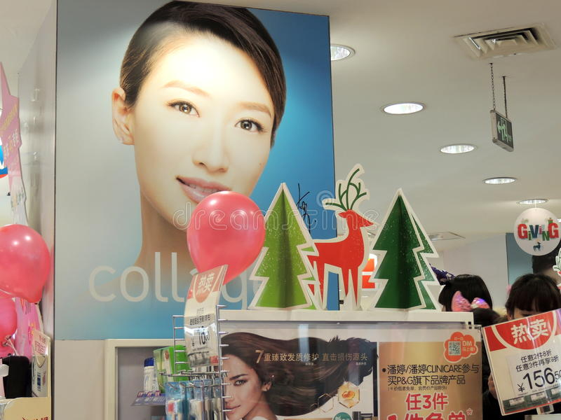 Christmas decorations in shop in China. A hygiene and beauty products watson's store in Hefei displays balloons, Christmas tree and deer on a shelf of hair royalty free stock photos
